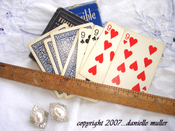 Vintage_playing_cards_ruler_and_ear