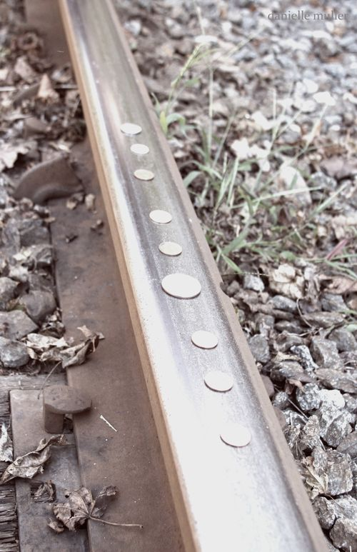 Coins on train tracks